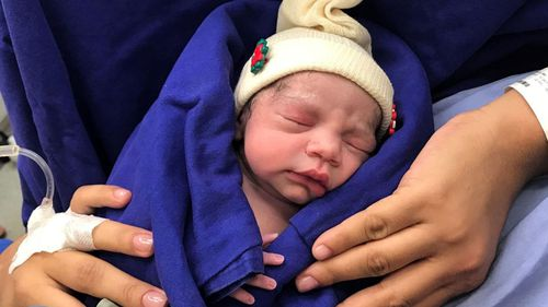 The healthy baby, whose mother was born without a uterus.