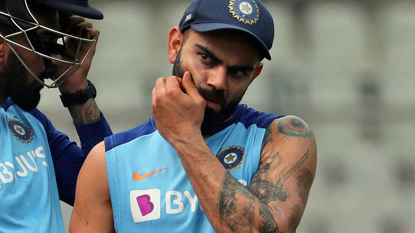 India's Shikhar Dhawan, left, chats with captain Virat Kohli as they attend a training session ahead of their first one-day international cricket match against Australia