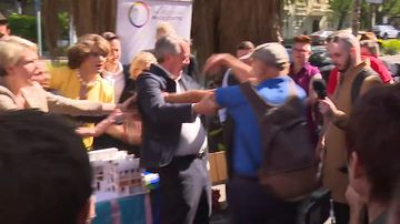 Equality Minister pushed and shoved by angry protester