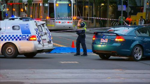 A female pedestrian has died after being hit by a truck on Collins Street in Melbourne. (9NEWS)