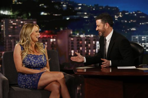 "This image released by ABC shows adult film star Stormy Daniels, left, laughs with host Jimmy Kimmel during an appearance on ""Jimmy Kimmel Live!"" (AAP)"