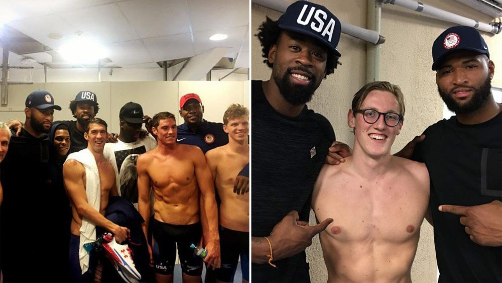 Michael Phelps and Mack Horton pose with the Dream Team. (Instagram)