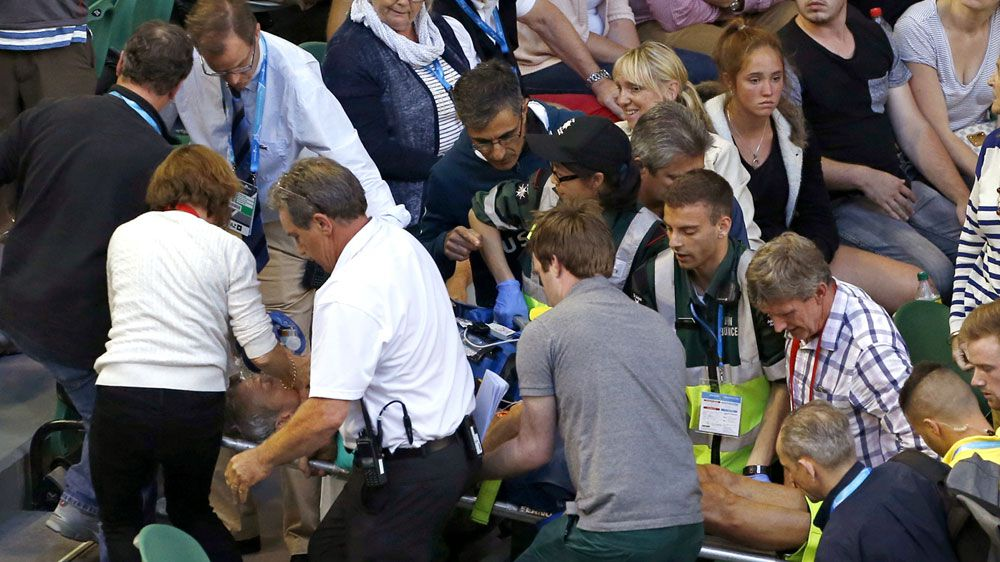 Medics carry Nigel Sears from Rod Laver Arena (AAP)