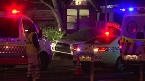The man's vehicle left Concord Road and hit the tree in front of the Rhodes Fire Station. Picture: 9NEWS.