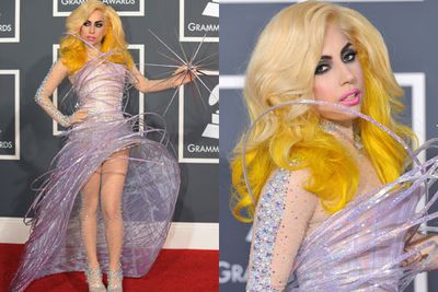Lady Gaga, what is going on here?!<br/><br/>To us, it looks like a huge ball of sparkly, purple twine exploded and formed a dress...taking attention away from her yellow hair. <br/><br/>No, not blonde...Y-E-L-L-O-W.