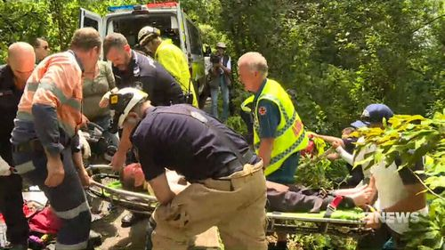 Emergency crews had to rig ropes up to Paul Robinson's stretcher to haul him up the hill. (9NEWS)