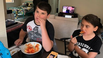 Boy eating lasagne too hot