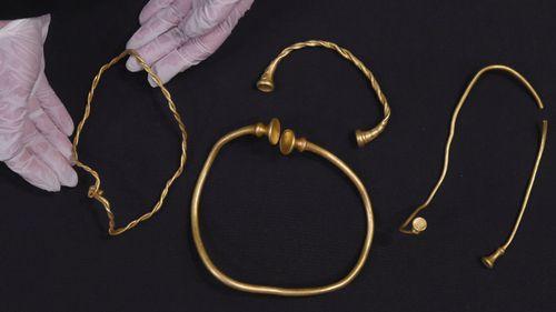 Metal detector enthusiasts strike gold in muddy UK field