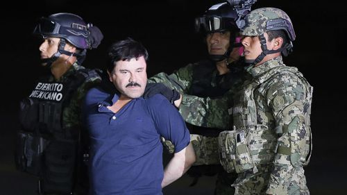 Mexican drug lord Joaquin 'El Chapo' Guzman is escorted by the authorities to a Mexican Army helicopter in 2016, to be transferred to the prison from which he escaped on 11 July 2015.
