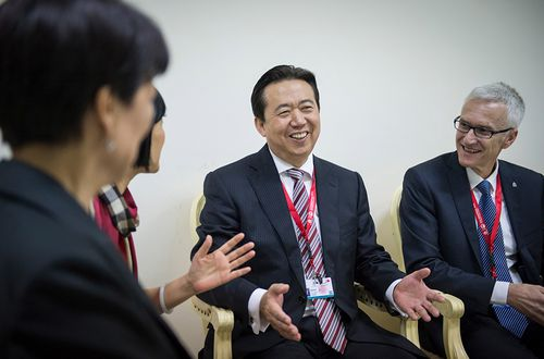 China's Meng Hongwei (C), elected President of Interpol speaking in Bali, Indonesia