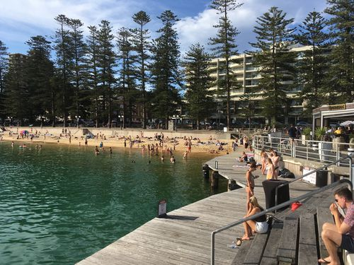 Locals in Manly cooled down at the wharf while temperatures stayed above 30 degrees even after 5pm.