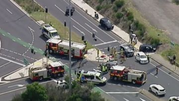 Emergency services swarm the scene of the four-car smash.