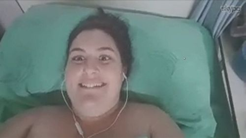 Ms Liddle making a video from her Thailand hospital bed. (Supplied)