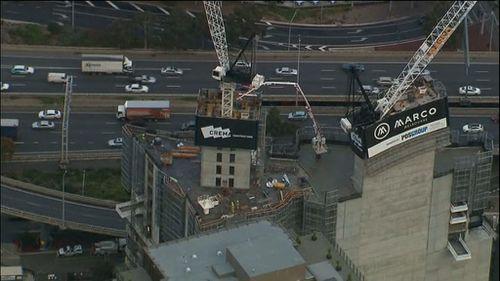 One man injured in Melbourne CBD crane collapse accident