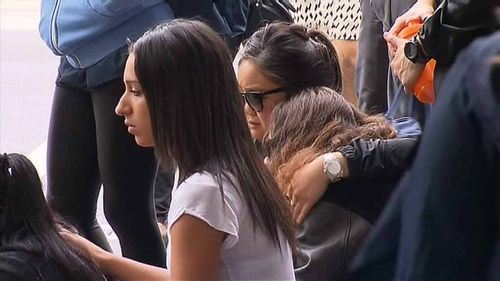 Friends gather at the scene to mourn their friend. (9NEWS)