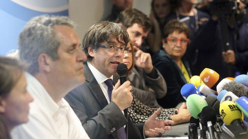Mr Puigdemont, 55, is a former journalist and mayor of Girona who was thrust to the forefront of Catalonia's independence push. (PA/AAP)
