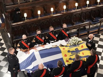 The Queen watches as Philip's coffin is placed in St George's Chapel