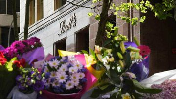 Floral tributes appeared outside the Lindt cafe following the siege. (AAP)