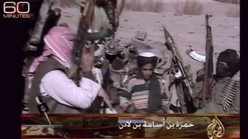Hamza bin Laden sits between armed fighters from the al Qaeda group. Source: 60 Minutes