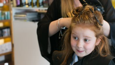 Pint-size hair accessory designer Pixie Curtis gets styled for back-to-school. Image: Parker Blain.