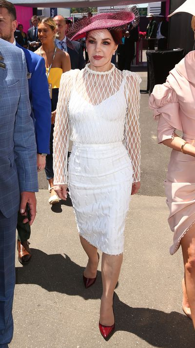 <p>After the monochrome madness of Derby Day and the high-voltage glamour of Melbourne Cup, today is the most fashionable day on the racing calendar  —  Oaks Day, known as Ladies' Day.</p> <p>The ex-wife of Elvis Presley and one-time mother-in-law of Michael Jackson, Priscilla Presley, made a show-stopping entrance to Flemington in a white, mesh ensemble with a pair of plum-coloured stilettos and matching hat adding a dramatic touch. Priscilla was also the step-grandmother of Paris Jackson who attended Derby and Cup Days. Still following?</p> <p>While Myer ambassadors Jennifer Hawkins and Rachael Finch were in perfect step with spring dressing in cool white and flirty florals.</p> <p>Stay up to date with who leads the fashion race on the style finale of the Spring Carnival.</p>