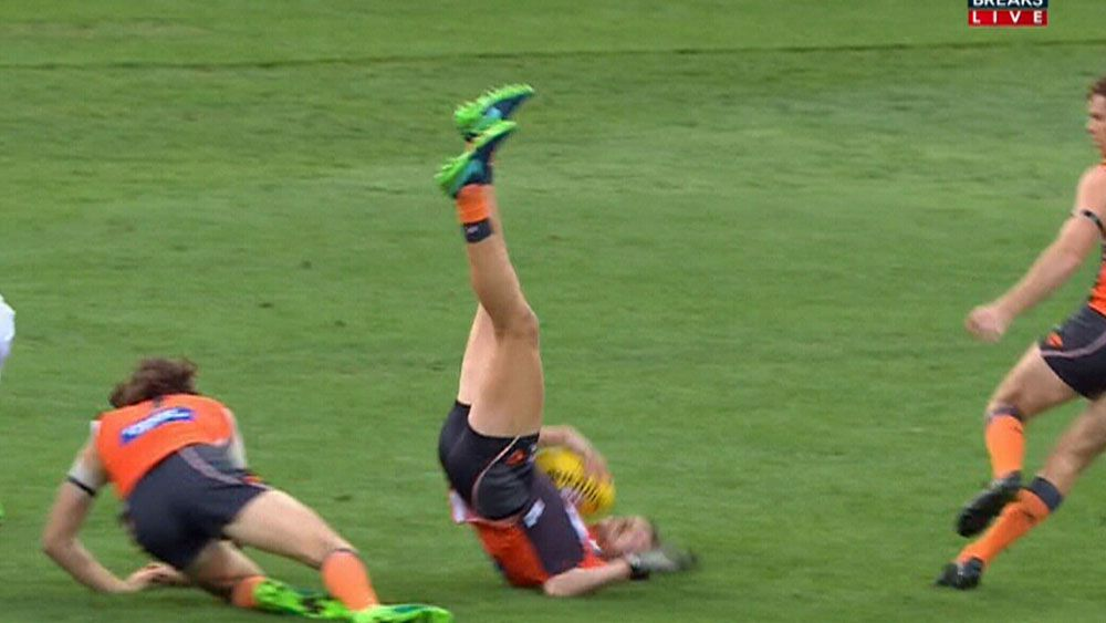 GWS Giants player Aidan Corr hits the ground at a bad angle. (Fox Sports)