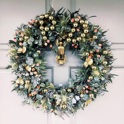 """Poppy Delevingne's <a href=""""https://www.instagram.com/a_riot_of_colour/"""" target=""""_blank"""">A Riot Of Colour</a> wreath, a gift from luxe e-tailer Moda Operandi."""