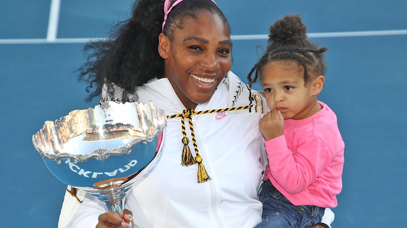 Serena Williams holds her daughter Olympia