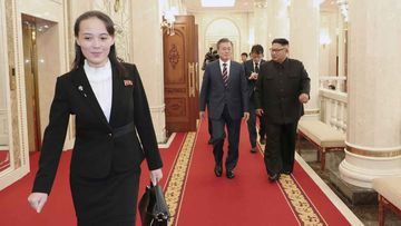 Kim Yo Jong walks ahead of South Korean President Moon Jae-in and North Koran leader Kim Jong Un, right, arrive at the headquarters of the Central Committee of the Workers' Party in Pyongyang, North Korea.