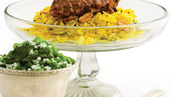 Pepper chicken chettinad (shown with lemon rice and stirfried green beans)