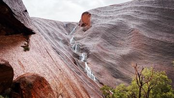 Waterfalls at Uluru during 'magical' weather event