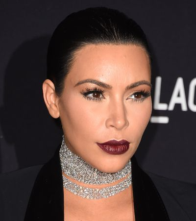 """<p>You might be inclined to reach for classic red lippie this party season, but stop for a season refresh. The sexy statement lip this time around is much, much darker than the last time you pulled a cracker. Just check out Kim Kardashian's gothic glam lip here.</p> <p>From runways to red carpets it's all about the rouge-noir lip, from deep plum to matte magenta. At Atelier Versace in Milan, models wowed with glittered ombre lips in rich berry while the lip stains at Antonio Marras were pressed on and plum-coloured.</p> <p>So how do you skip looking like a '90s goth gone wrong?  First up, keep the rest of your makeup  minimal - that means no blush or bright eyeshadows. Secondly, ditch pale, velvety foundation for a modern finish of second-skin honey-hued dewy.</p> <p>""""When wearing a dark lip, whether matte or glossy, don't have a lot of other products on the face,"""" says <a href=""""https://www.instagram.com/carol_mackie/"""" target=""""_blank"""">Carol Mackie</a>, Senior Artist, M.A.C Cosmetics. """"And don't perfect your lip straight away. Just get the product on then shape and tidy with lip liner."""" For a modern finish, Mackie recommends starting with  M.A.C Lip Mix, which hug the lips, then slicking with gloss. </p> <p> Swipe through our gallery to get some Bordeaux lip inspo plus our plum product picks of the season.</p>"""