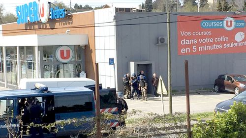 An image posted on Twitter appears to show police at the Super U supermarket in Trebes, in southern France. (Twitter)