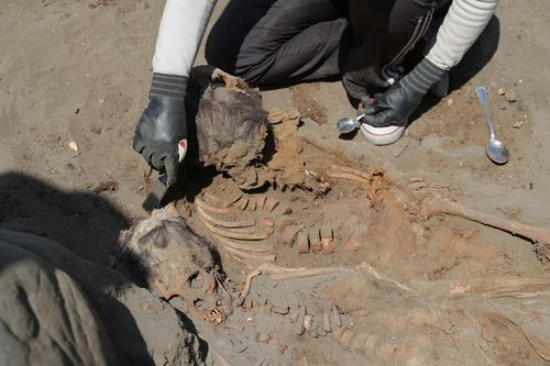 Archaeologists at an excavation in Peru.