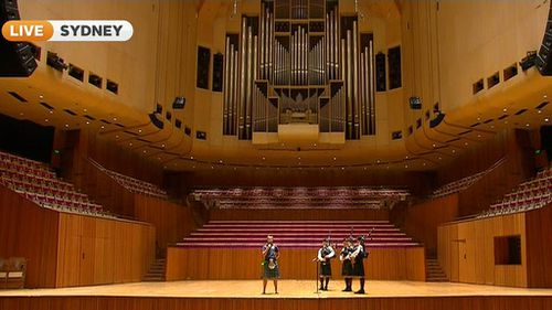 Cancer survivor Greig Trout onstage at the Sydney Opera House. (9NEWS)