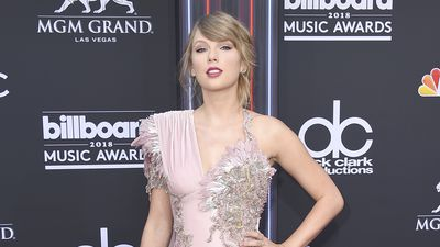 Taylor Swift leads the best dressed list with thigh-high split