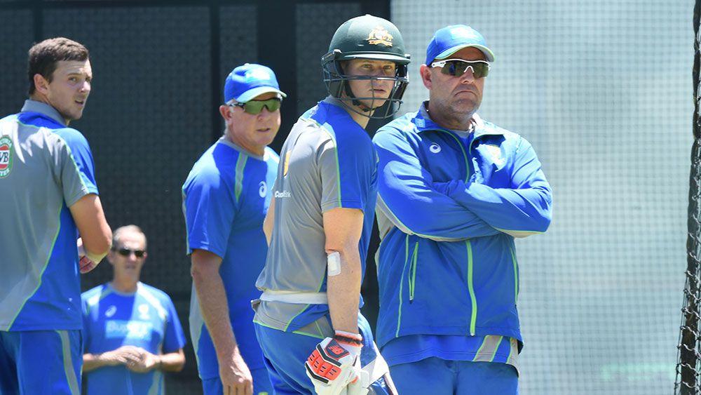 Steve Smith and Darren Lehmann watch on at Australia training. (AAP)