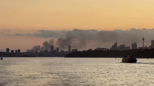 Smoke from the blaze can be seen along Sydney's skyline.