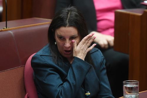 She wipes back tears after making her emotional address (Image: AAP)
