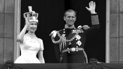 The Queen and Prince Philip wave to the crowds following her coronation at Westminster in 1953. (AFP)