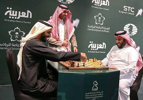 Two Saudi officials play chess during the opening the first ever chess tournament in Riyadh. Saudi Arabia is hosting a world chess tournament for the first time on Tuesday nearly two years after the country's top cleric issued a religious edict against playing the board game. (Saudi Press Agency via AP)