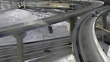 A Wisconsin driver is lucky to be alive after plunging off a highway overpass.