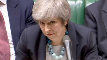 UK Prime Minister Theresa May addresses the House of Commons as she announces a postponement to a crucial vote on her Brexit deal.