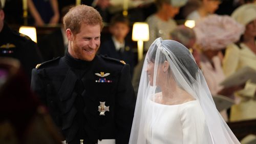 The happy couple smile as they prepare to say their vows. Picture: PA
