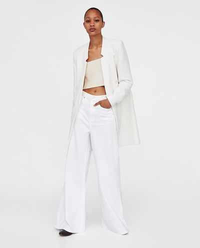 "<a href=""https://www.zara.com/au/en/textured-weave-coat-p02706607.html?v1=6295579&amp;v2=1009742"" target=""_blank"">Zara Textured Weave Coat in Ecru, $139</a>"