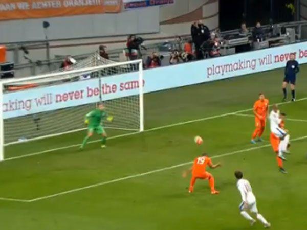Robin Van Persie heads the ball toward the Dutch goal. (Supplied)