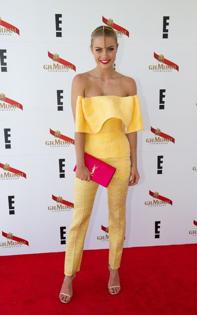 "<p>Hit: Model Elyse Knowles in Toni Maticevski stands out in yellow after the red alert of <a href=""http://honey.nine.com.au/2016/11/01/09/55/melbourne-cup-2016-fashion"" target=""_blank"">Cup Day</a>. Bonus points for the colour pop of the hot pink YSL clutch.</p> <p>Miss: While we love the drama of the Suzy O'Rourke headpiece, Elyse's slick back hair borders on Robocop severity. High impact is always impressive but soft blonde waves would have won our Phar Lap-sized hearts over completely.</p>"