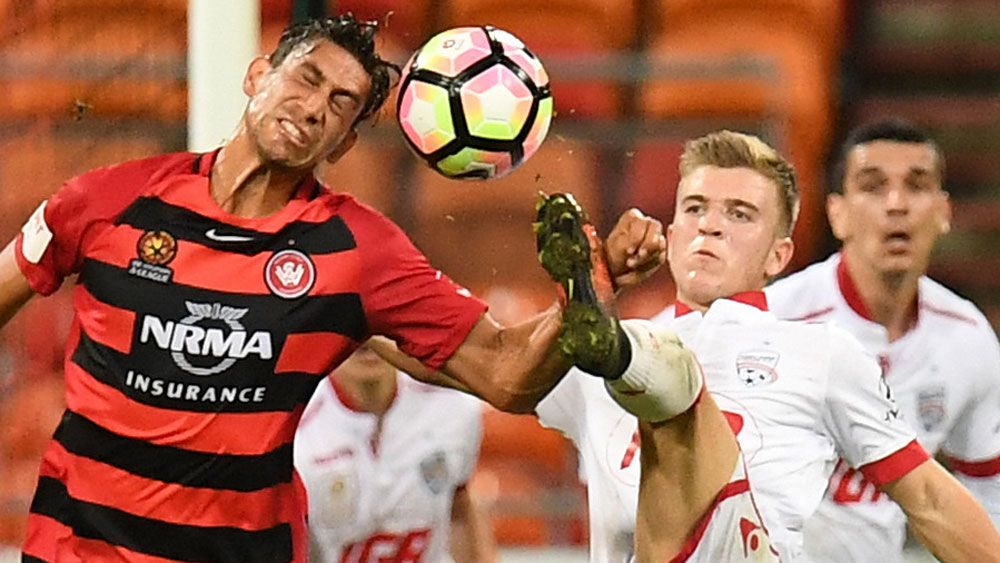 Wanderers midfielder Bruno Pinatares and Adelaide United's Riley McGree. (AAP)