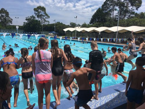 Kids dive into the pool at Ripples Penrith on the hottest December day on record. Picture: Laura Tunstall.