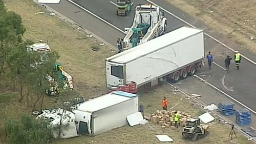 The truck careered across two lanes and hit an unoccupied car parked in an emergency stopping lane. (9NEWS)